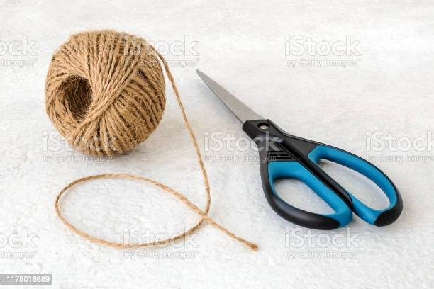 Natural hemp cord ball and scissors on a rough white surface roll of picture id1178016689?b=1&k=6&m=1178016689&s=612x612&h=y1oldgmk7eicd1zfhxuvy cga8qounvkcyqy951lk0g=