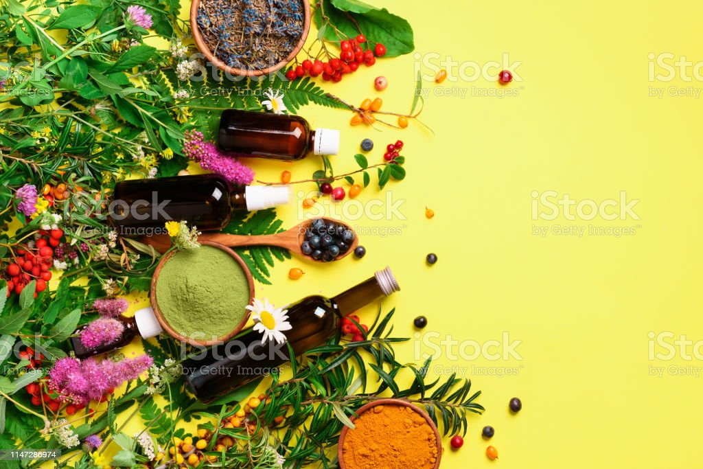 Natural herbal ingredients for alternative medicine on yellow...