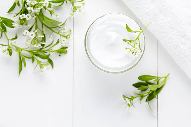 Natural herbal spa cosmetic hygienic cream with flowers skincare product stock photo