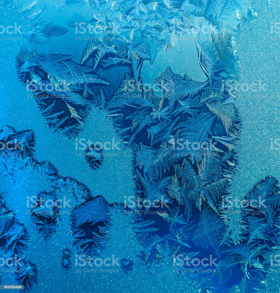Natural ice pattern on winter glass stock photo