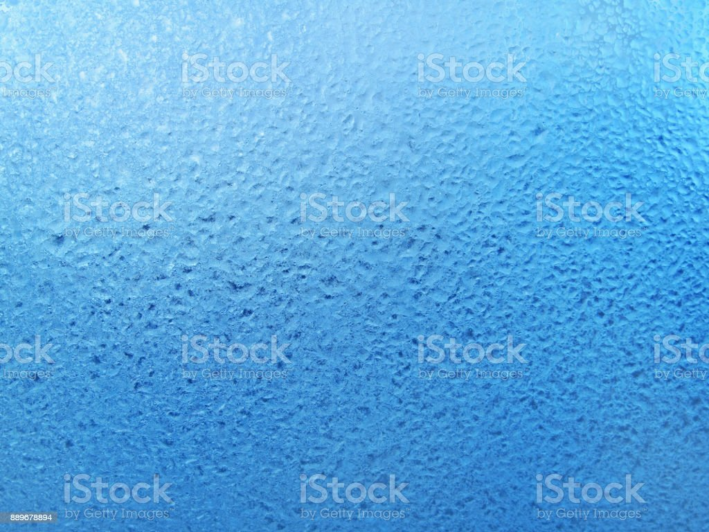 Natural ice pattern with frozen water drops on winter glass stock photo