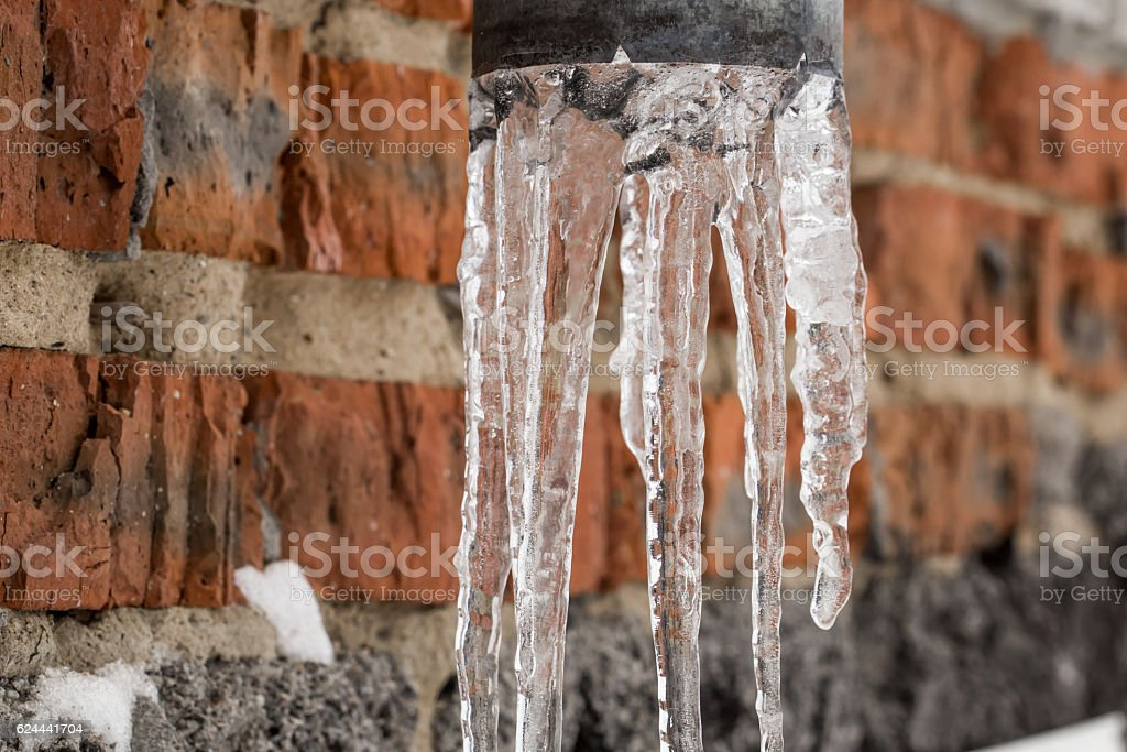 Natural icicles hanging on the pipe stock photo