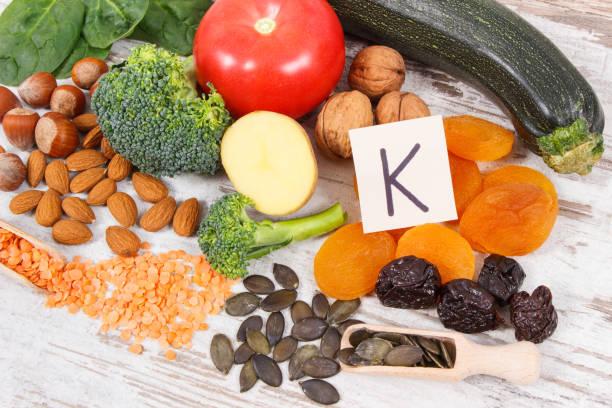 natural ingredients as source potassium, vitamin k, minerals and fiber - буква k стоковые фото и изображения