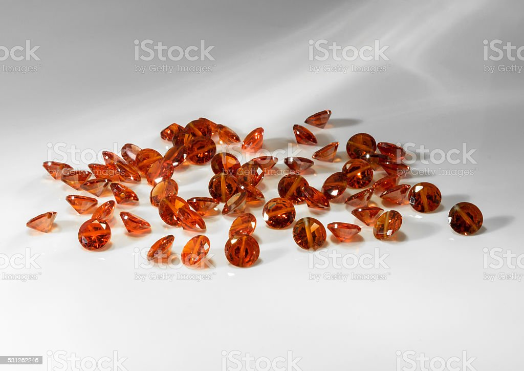 Natural jewelry gemstones red zircon bead on a gray background stock photo