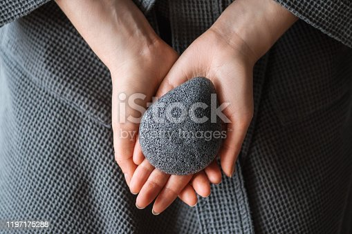 Natural konjac sponge in a female hands, healthy lifestyle.