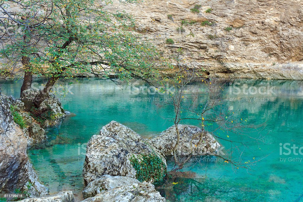 Natural landmark in the Provence: Fontaine de Vaucluse stock photo