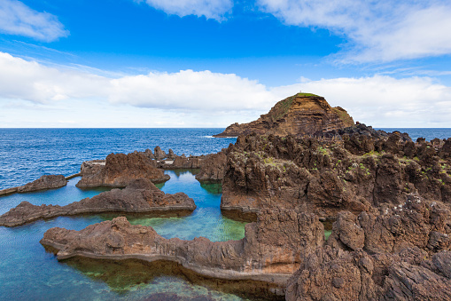 Natural Lava Rock Swimming Pools Stock Photo - Download Image Now