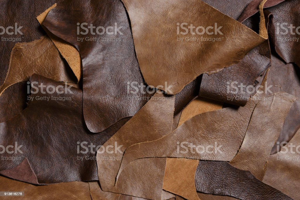 Natural leather in the tailoring workshop. Top view. stock photo