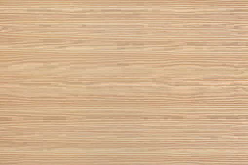 Light natural wood texture. The board have a strong clear texture of wood without damages. A wood grain pattern featuring even grains of wood running horizontally across the image.