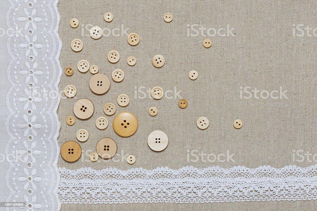 Natürlichen Leinen-Textur mit weißen Spitzen und Knöpfen – Foto