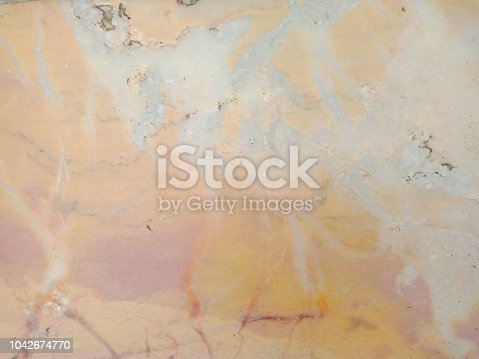 1015475992istockphoto Natural marble orange-pink background - texture. 1042674770