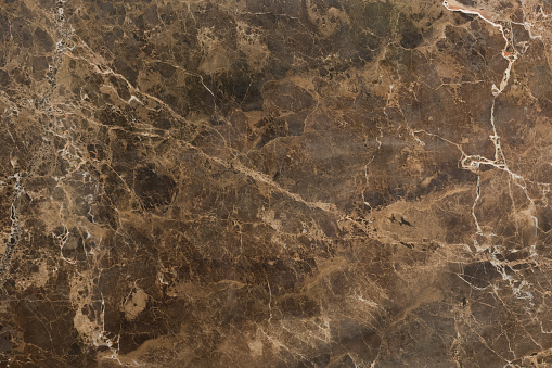 Natural marble texture in brown colour. High resolution photo.