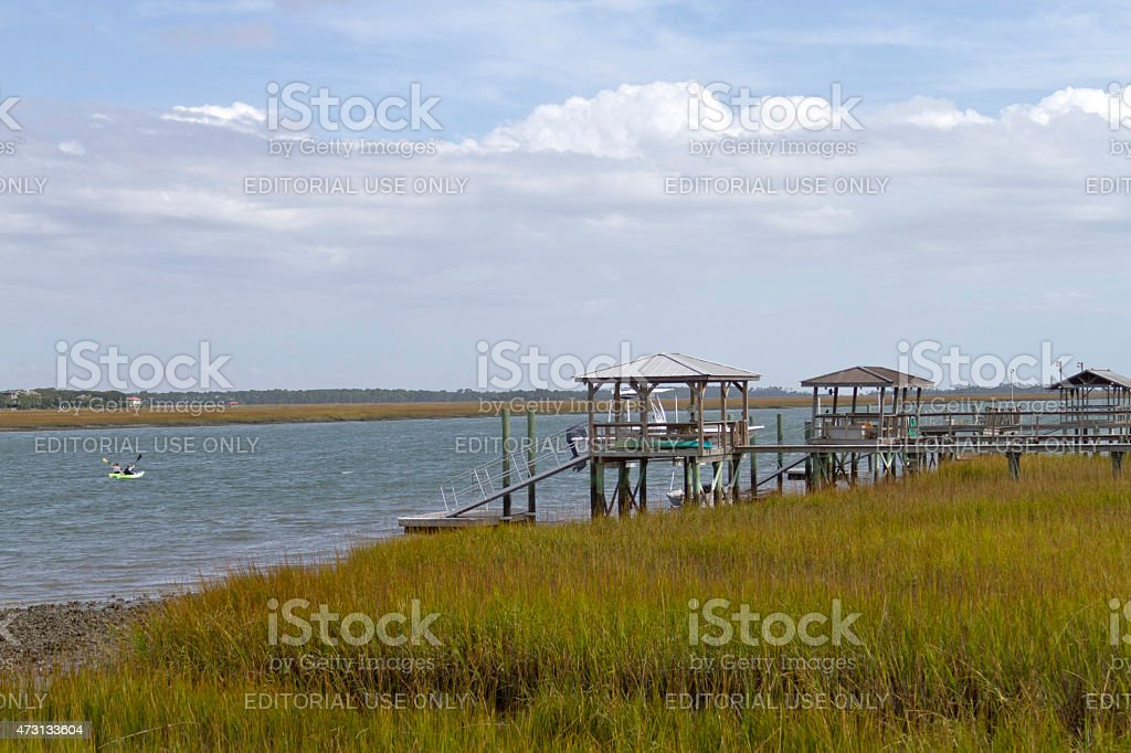 Natural Marsh and Distant Kayakers stock photo