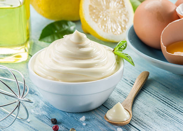Natural mayonnaise ingredients and the sauce itself. stock photo