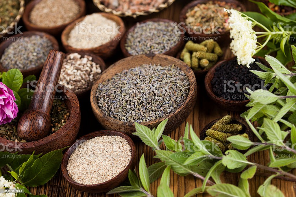 Natural medicine, wooden table background stock photo