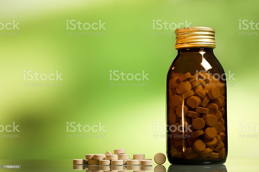 natural medicines, pills,glass bottle royalty-free stock photo