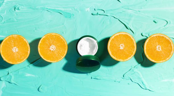 Natural moisturizer with orange and vitamin C stock photo