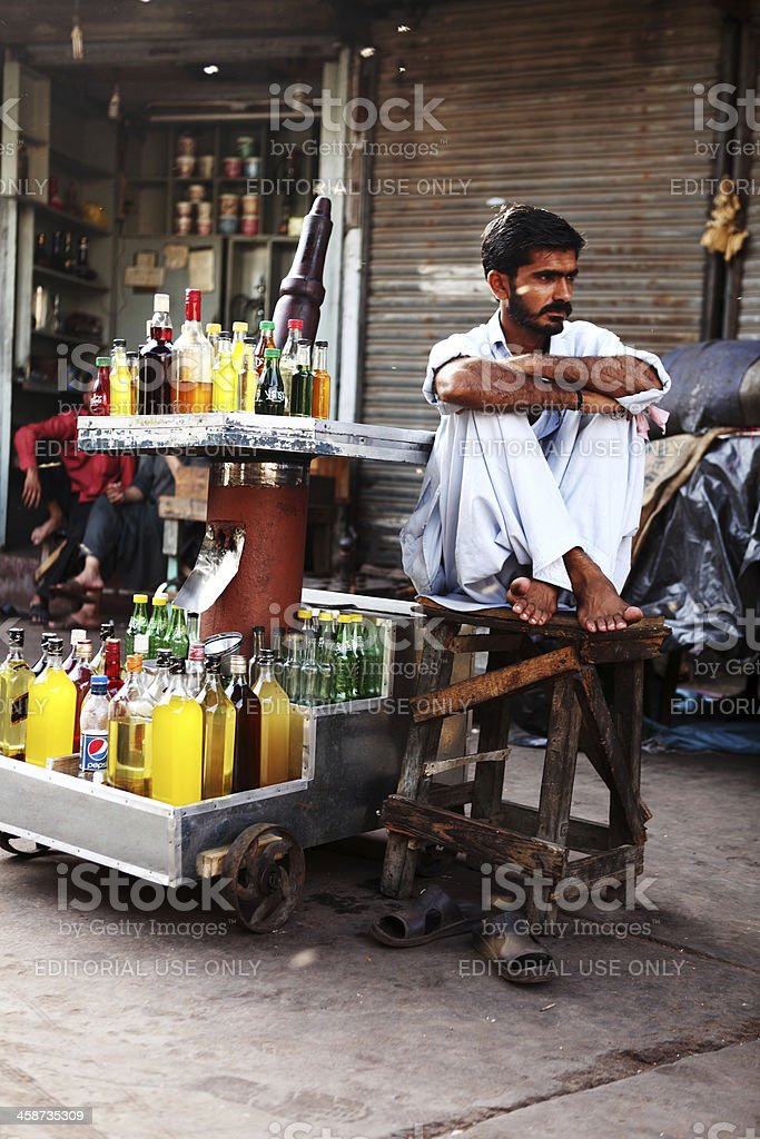 Natural Oil Extractor sitting beside Traditional Wooden Expeller stock photo
