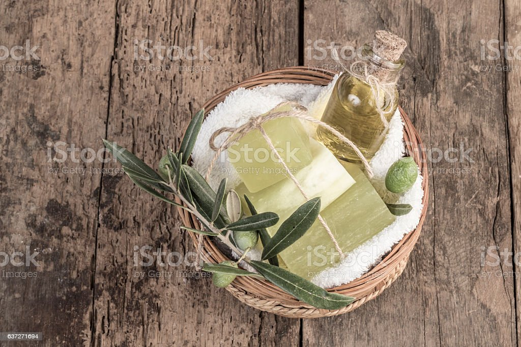 natural olive oil soap bars and olive oil on table - foto de acervo
