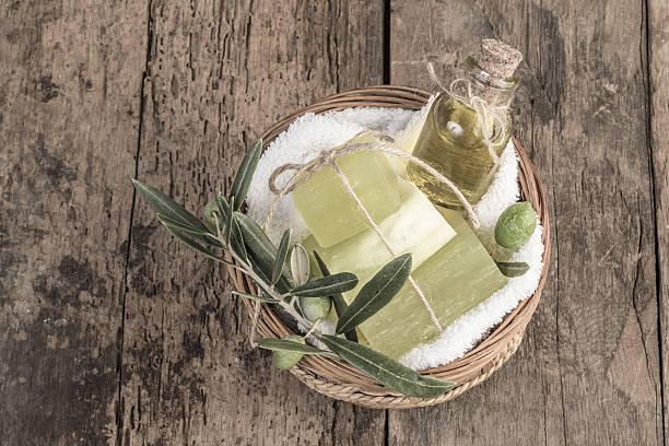 natural olive oil soap bars and olive oil on table stock photo