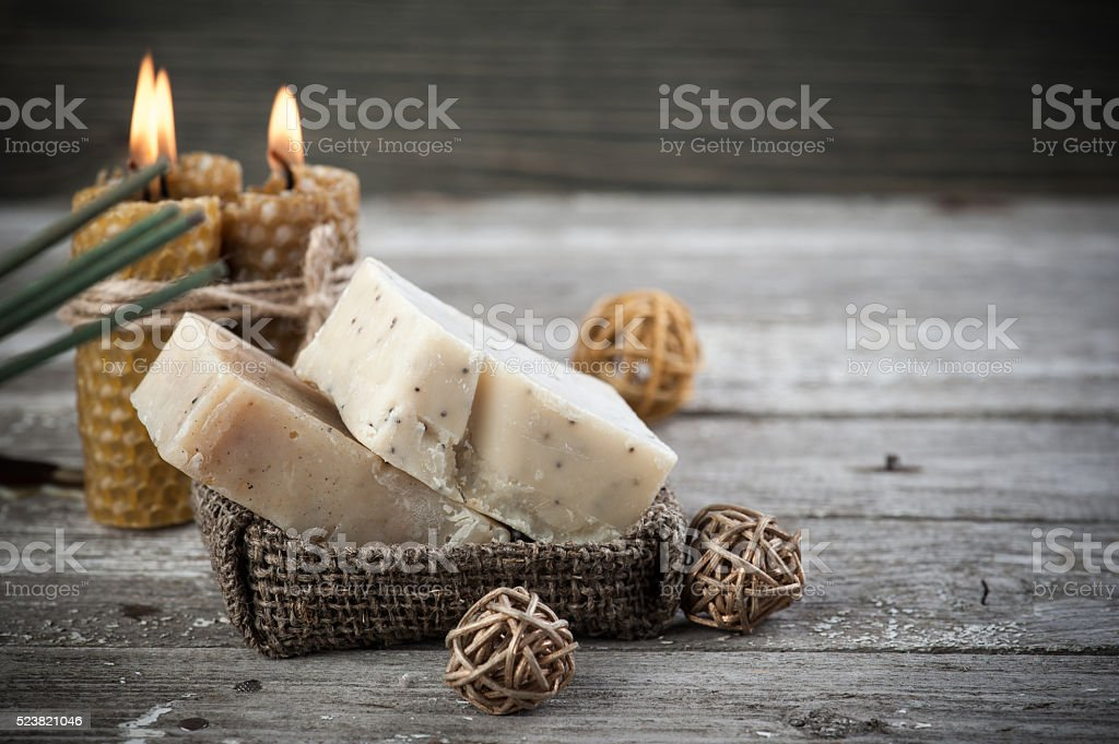 natural olive soap and honey candles stock photo