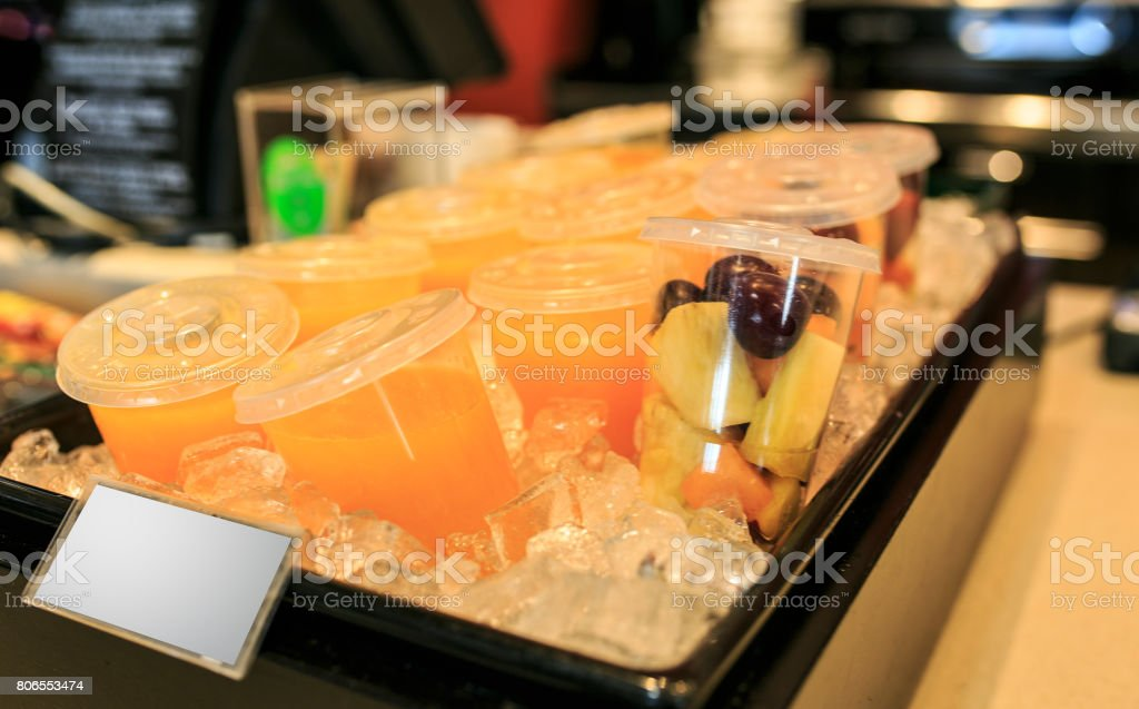 Natural orange juice in ice stock photo