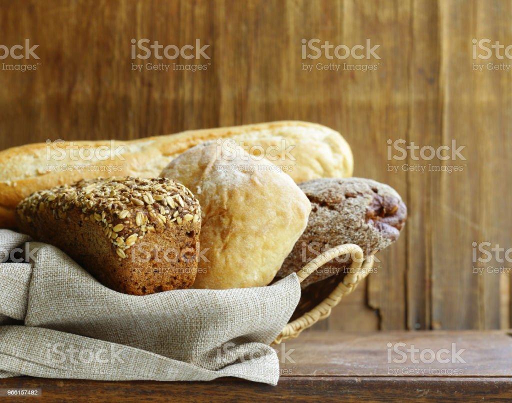 natural organic bread assortment - Стоковые фото Багет роялти-фри