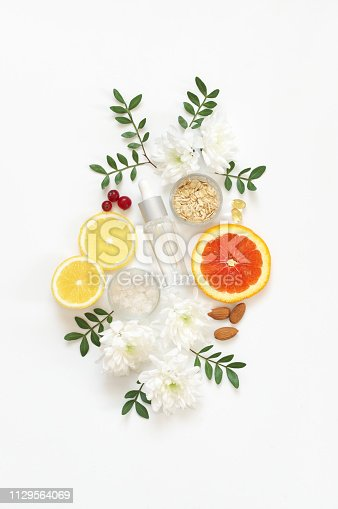 Composition of natural organic cosmetics, ingredients and flowers on white background. Top view point, flat lay.