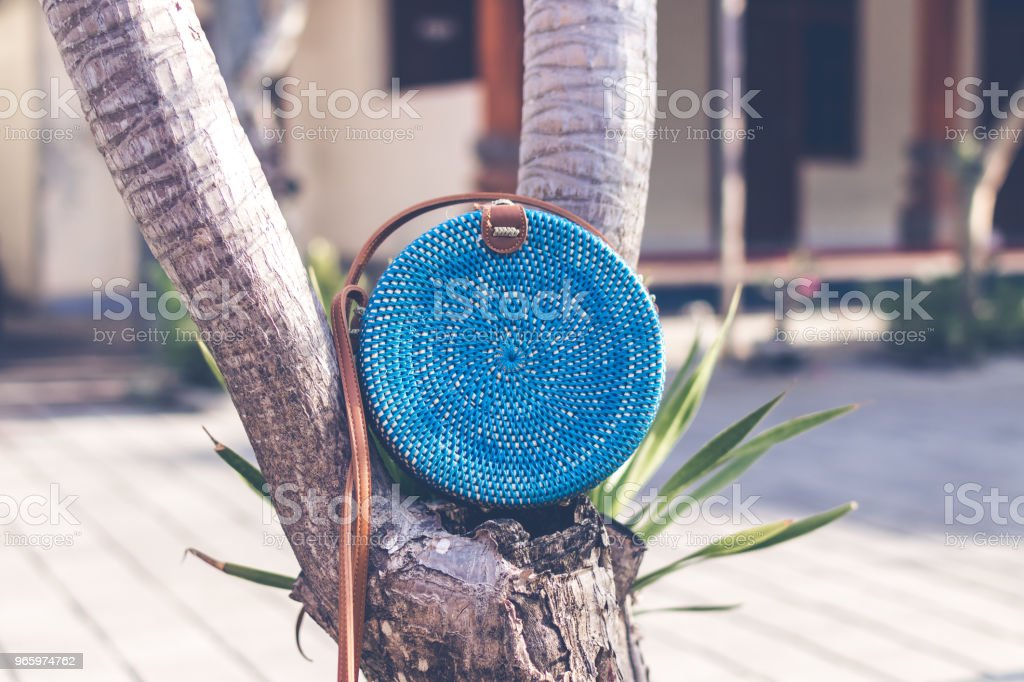 Natural organic handmade rattan handbag closeup. Blue color - Royalty-free Archival Stock Photo