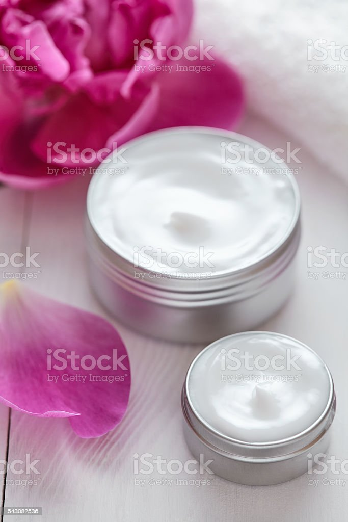 Natural organic herbal cosmetic cream with flowers vitamin spa lotion stock photo