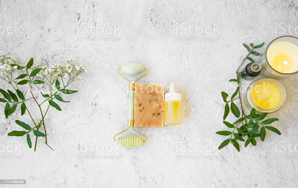 Natural Organic Skincare Products On Concrete Background Top View Green Natural Skincare And Beauty With Flowers Natural Soapjade Roller Essential Oils Bottles Floral Extracts And Candle Stock Photo Download Image Now