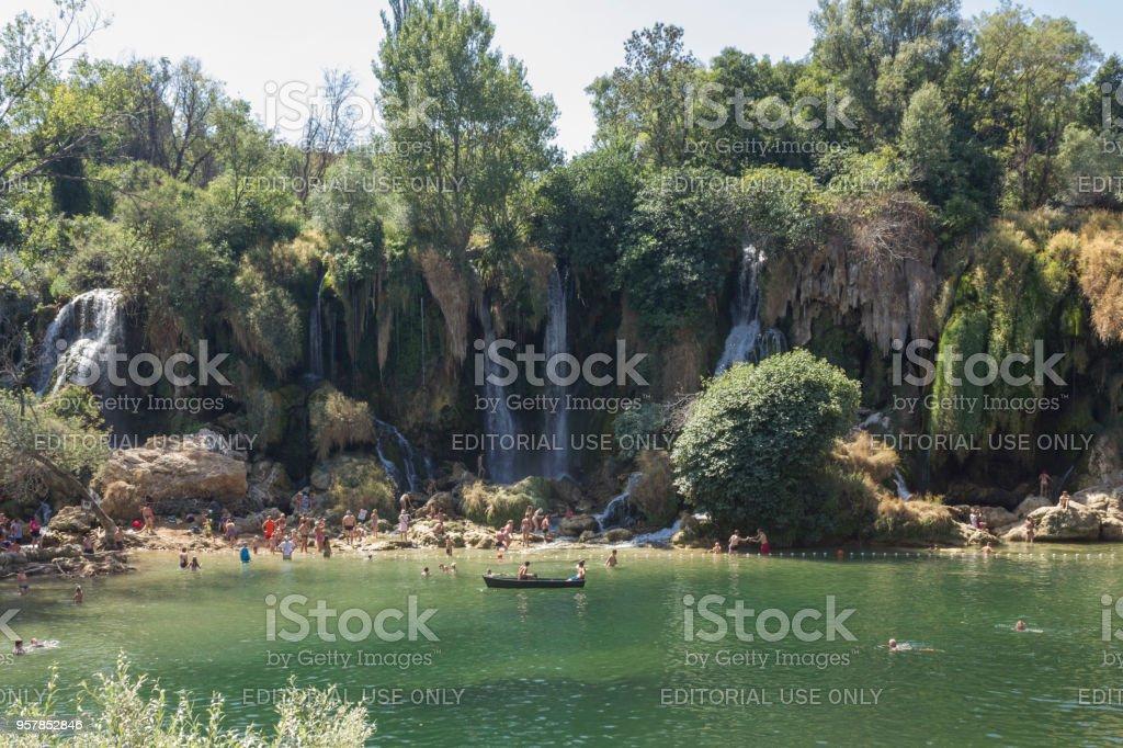 Natural parkland ok Kravice waterfalls in Bosnia Herzegovina, with people around stock photo
