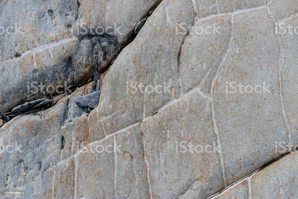 Natural pattern in a rock face. stock photo