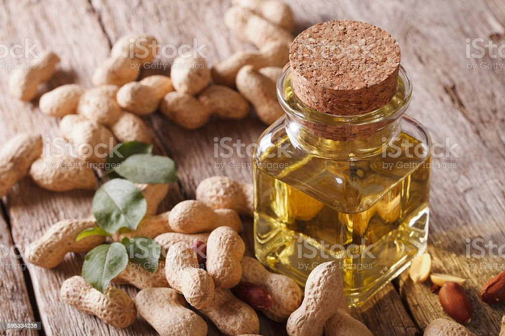 Natural peanut oil in a glass jar close up. Horizontal stock photo