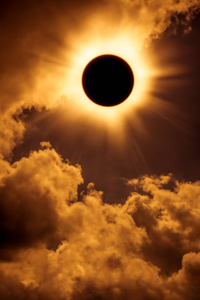Natural phenomenon. Solar eclipse space on gold sky background. stock photo