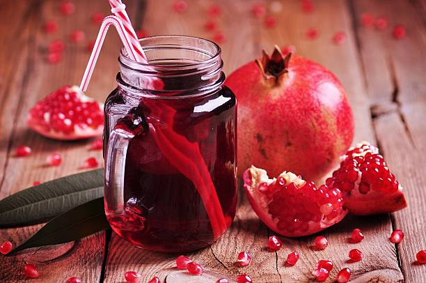 Natural pomegranate juice in a Mason jar stock photo