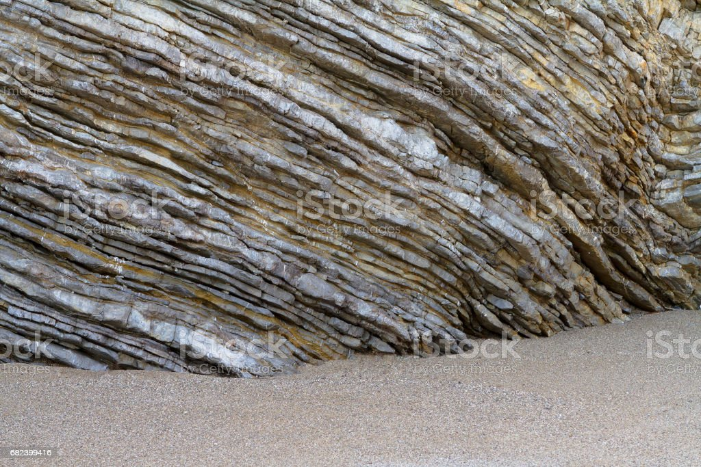 Natural rippled stone and sand, seashore background. royalty-free stock photo