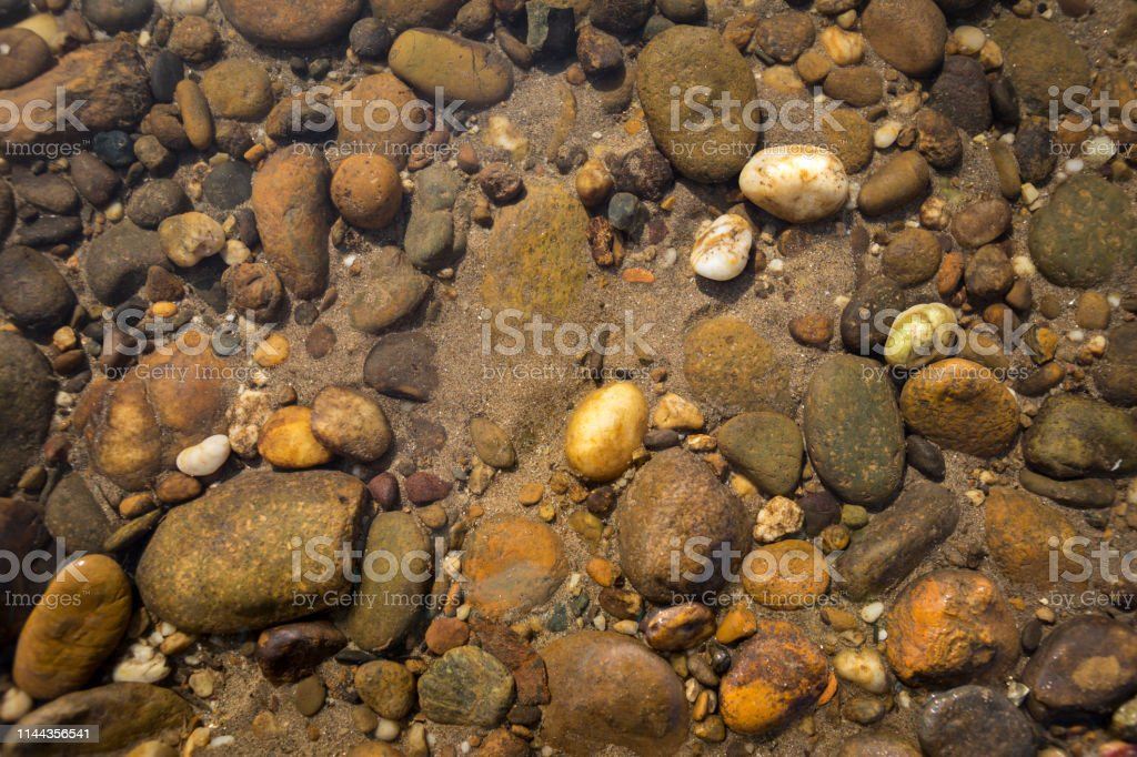 Natural river stone under the clear river water, natural concept,...