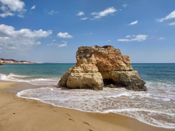 Natural rock on Albufeira water's edge. stock photo