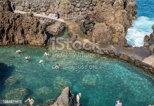 Porto Moniz, Madeira, Portugal - April 18, 2018: Natural rock pool of Porto Moniz on Madeira Island. Portugal.  It is a public bath with water from the Atlantic Ocean.