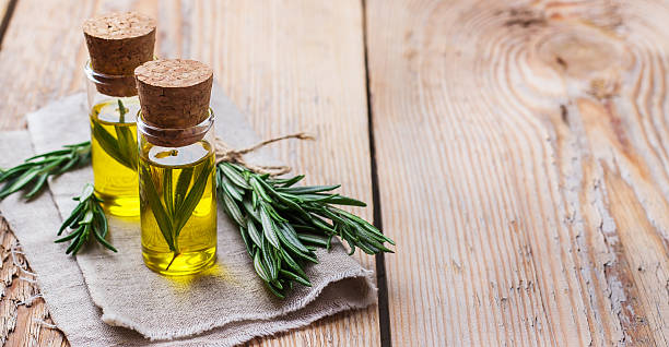 natural rosemary essential oil for beauty and spa - 로즈마리 뉴스 사진 이미지
