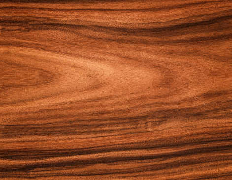High resolution image of natural unstained rosewood with very slight vignette lighting. Rosewood is a rare and beautiful product often used for musical instruments, especially guitars.