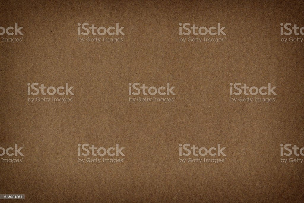 Natural rough dark brown paper background stock photo