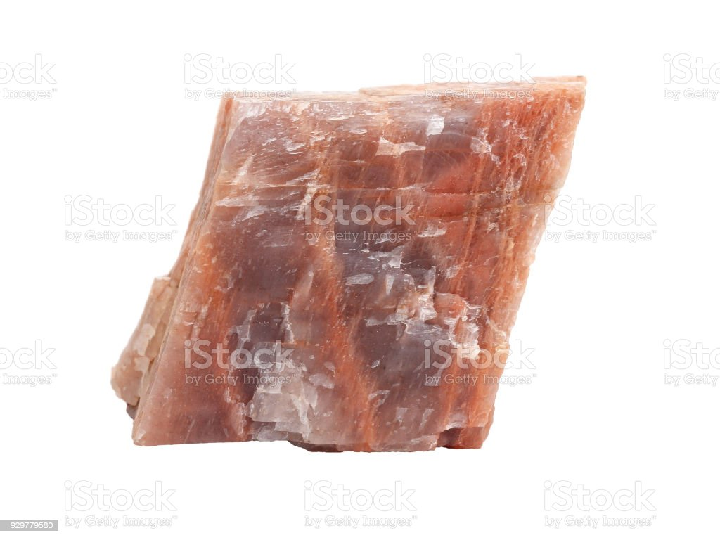 Natural sample of microcline feldspar, important igneous rock-forming silicate mineral on white background stock photo