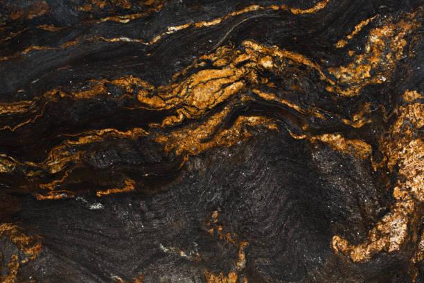 natural slate with shades of gold and black. - mármore rocha imagens e fotografias de stock