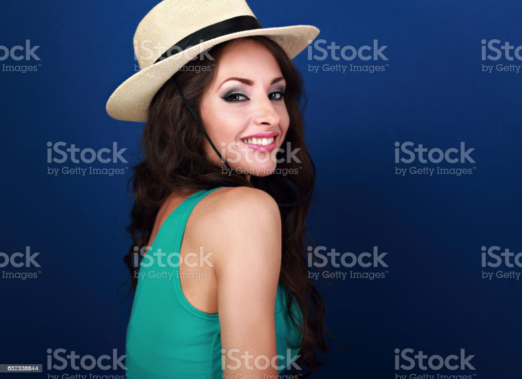 3a1f89e381d Natural smiling beautiful woman in straw summer hat with long curly hair  style looking on blue background. Closeup bright portrait - Stock image .