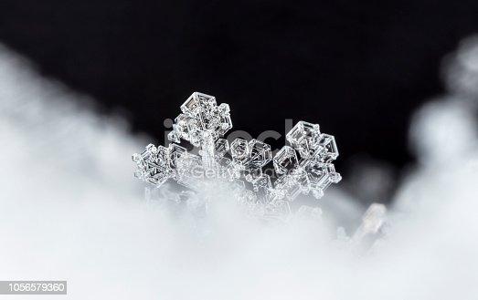 istock natural snowflakes on snow 1056579360