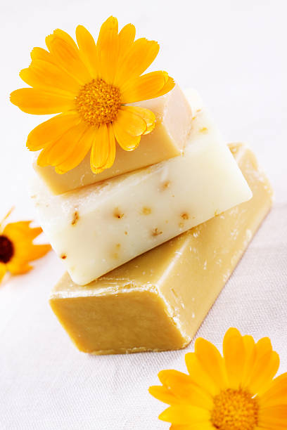 Natural soap with marigold flowers close up stock photo