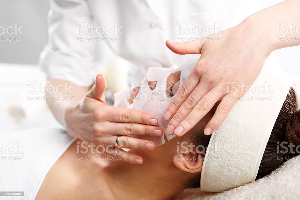 Natural spa, a woman in the mask collagen stock photo