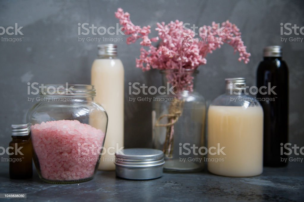 Natural spa cosmetics on a dark blue beton concrete background. Beauty blogger, minimalism concept stock photo